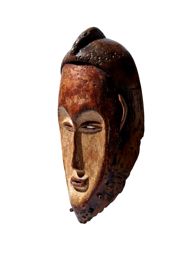 A wooden mask with pigments and covered with kaolin
