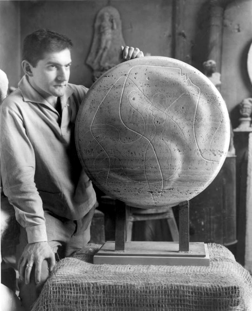 Photography of artist Stanley Lewis with a scolpture of his making