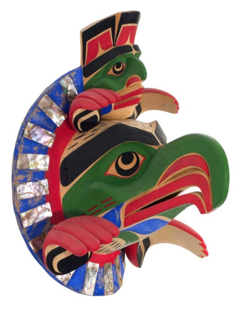 Ce masque de cèdre est réalisé par l'artiste Beau Dick en 1980